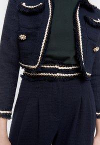 Uterqüe - MIT PASPELN - Trousers - dark blue - 4