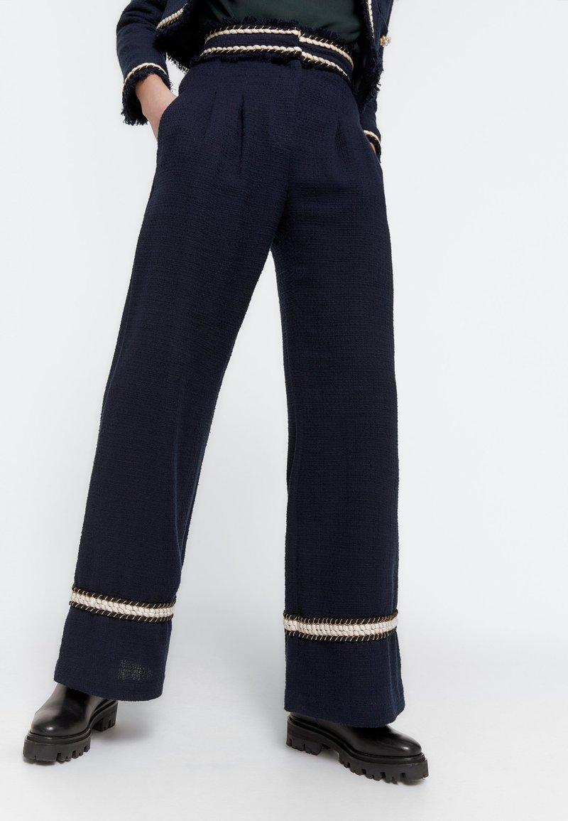 Uterqüe - MIT PASPELN - Trousers - dark blue