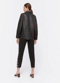 Uterqüe - MIT STRASS - Spodnie treningowe - black - 2