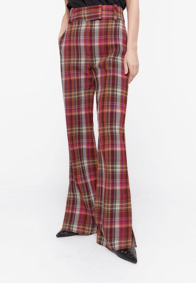MIT BUNTEN KAROS - Trousers - red