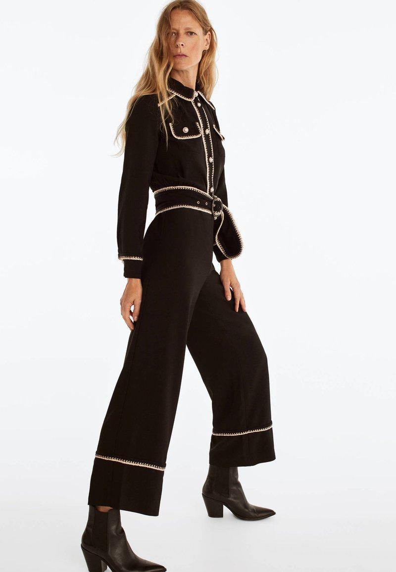 Uterqüe - MIT PERLEN UND PASPELN  - Jumpsuit - black