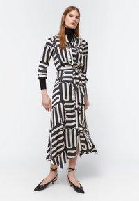 Uterqüe - Maxi šaty - black - 0