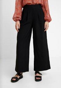 Vila - VIKAIRI WIDE PANTS - Trousers - black - 0