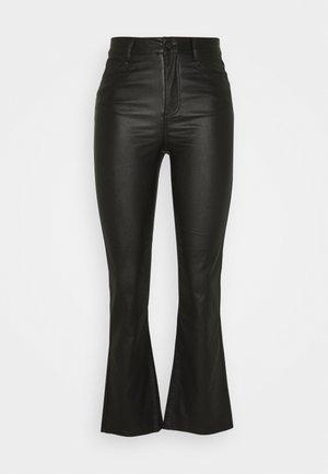 VICOMMIT COATED FLARED CROP - Kalhoty - black
