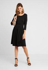 Vila - VITINNY  3/4 SLEEVE DOLL DRESS - Vestito di maglina - black - 1