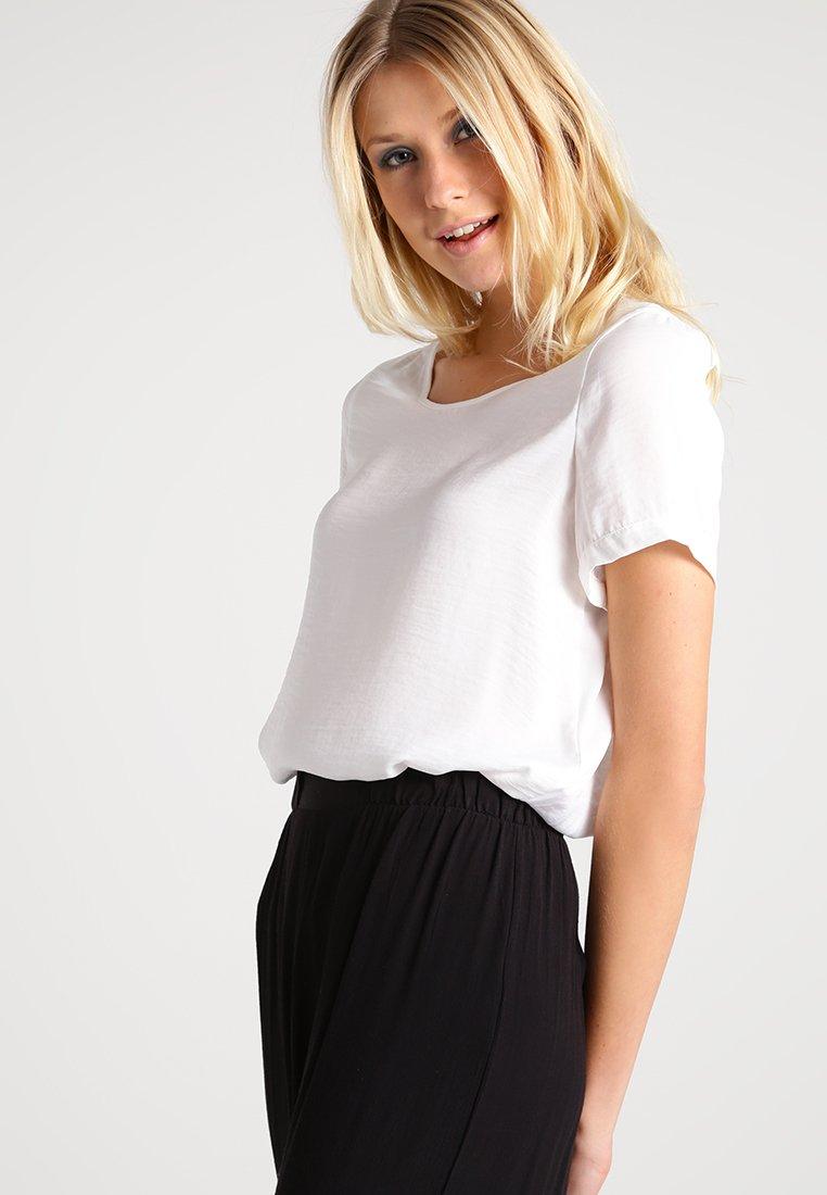Blusas y blusones de marca | Colección online en Zalando