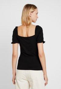 Vila - T-shirts med print - black - 2