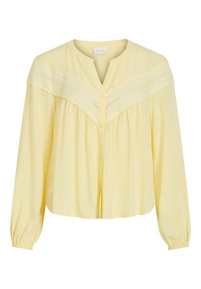Blus - mellow yellow
