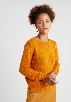 Stickad tröja - golden oak