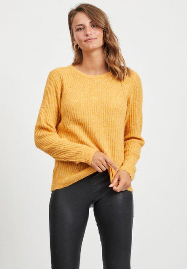 Stickad tröja - gold