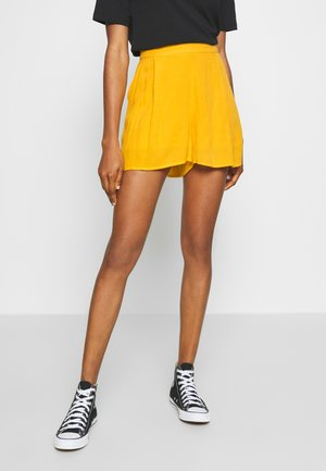 SUNNY FESTIVAL - Shorts - golden rod