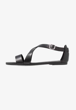 TIA - Sandaalit nilkkaremmillä - black