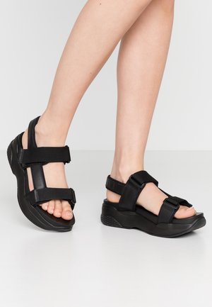 LORI - Korkeakorkoiset sandaalit - black