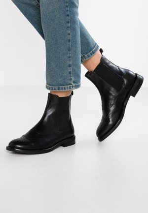 AMINA - Classic ankle boots - black