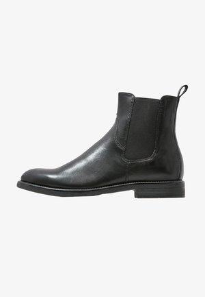 AMINA - Korte laarzen - black