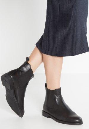 AMINA - Støvletter - black