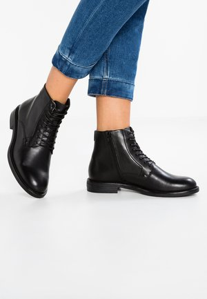 AMINA - Ankle boot - black