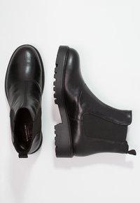 Vagabond - KENOVA - Kotníkové boty na platformě - black - 2