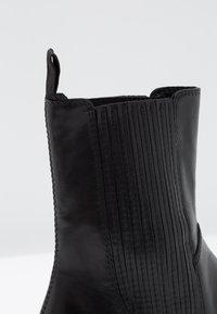 Vagabond - DIANE - Kotníkové boty na platformě - black - 2