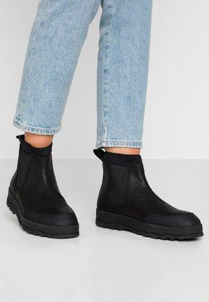 MILO - Kotníková obuv - black