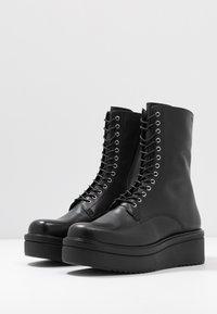 Vagabond - TARA - Platform ankle boots - black - 4