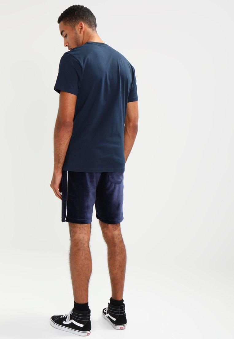 Vans CLASSIC - T-shirts med print - navy/white