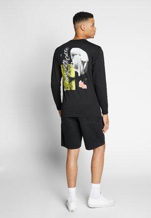 WARPED COLLAGE - Long sleeved top - black