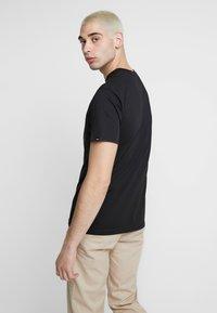 Vans - DIA SUGAR SKULL - T-shirt con stampa - black - 2