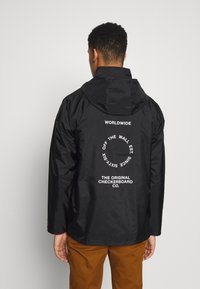 Vans - DISTORT TYPE ANORAK - Giacca a vento - black - 2