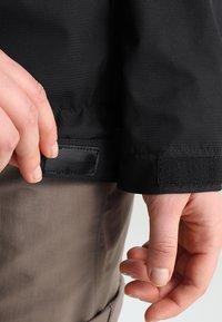Vaude - WOMEN ESCAPE LIGHT JACKET - Waterproof jacket - black - 5