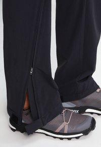 Vaude - WOMEN'S FARLEY STRETCH ZO T-ZIP PANTS 2-IN-1 - Kalhoty - black - 7