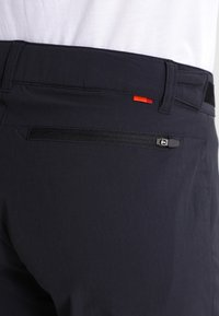 Vaude - WOMEN'S FARLEY STRETCH ZO T-ZIP PANTS 2-IN-1 - Kalhoty - black - 6