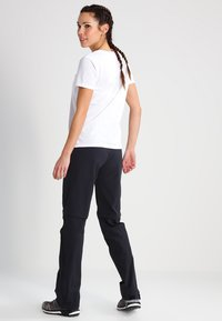 Vaude - WOMEN'S FARLEY STRETCH ZO T-ZIP PANTS 2-IN-1 - Kalhoty - black - 2
