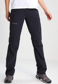 Vaude - WOMEN'S FARLEY STRETCH ZO T-ZIP PANTS 2-IN-1 - Kalhoty - black - 0