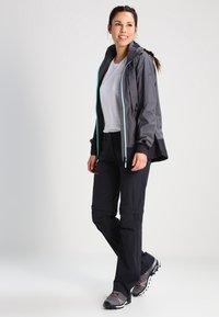 Vaude - WOMEN'S FARLEY STRETCH ZO T-ZIP PANTS 2-IN-1 - Kalhoty - black - 1