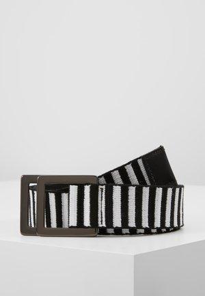 Pásek - schwarz/weiß