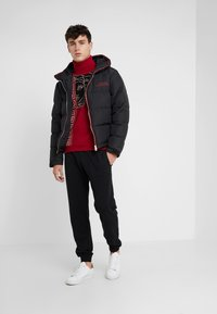 Versace Collection - SPORTIVO PANTALONE - Tracksuit bottoms - nero - 1