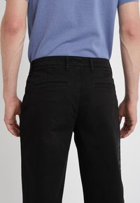 Versace Collection - PANTALONI TESSUTO - Trousers - nero - 3