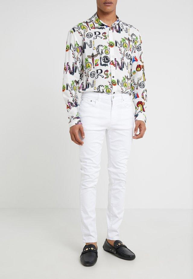 PANTALONE - Jeans Slim Fit - bianco