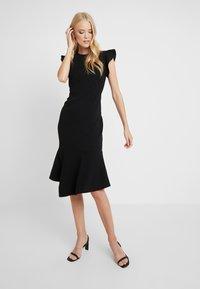 Vince Camuto - FLUTTER PEPLUM HEM DRESS - Pouzdrové šaty - rich black - 0