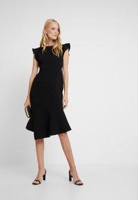 Vince Camuto - FLUTTER PEPLUM HEM DRESS - Pouzdrové šaty - rich black - 2