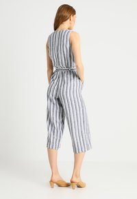 Vince Camuto - SHORE STRIPE BELTED - Jumpsuit - ultra white - 2