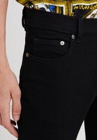 Versus Versace - PANTALONE  - Jeans Skinny - black - 5