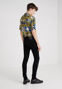 Versus Versace - PANTALONE  - Jeans Skinny - black - 2