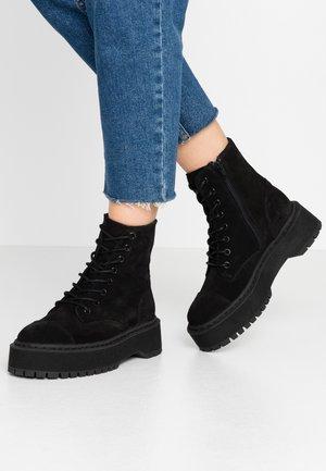 VMPATH BOOT - Platform ankle boots - black