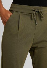 Vero Moda - VMEVA LOOSE STRING PANTS - Tracksuit bottoms - ivy green - 5