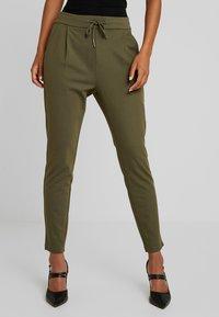 Vero Moda - VMEVA LOOSE STRING PANTS - Tracksuit bottoms - ivy green - 0