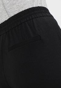 Vero Moda - VMEVA LOOSE STRING PANTS - Träningsbyxor - black - 5