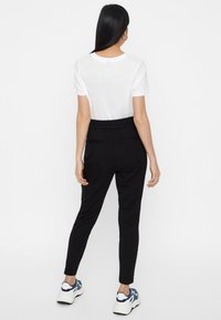 Vero Moda - VMEVA - Tracksuit bottoms - black - 2