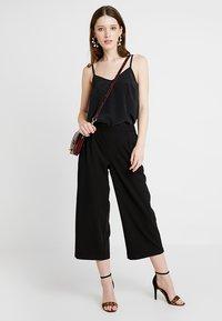 Vero Moda - VMCOCO CULOTTE PANTS - Kalhoty - black - 2